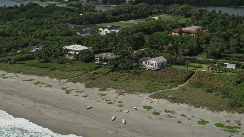 5K stock footage aerial video of beachfront homes in Hobe Sound, Florida Aerial Stock Footage | AX0019_031