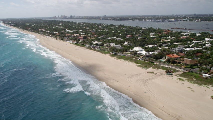 5K stock footage aerial video of a beach and coastal residential community in Palm Beach, Florida Aerial Stock Footage | AX0019_053