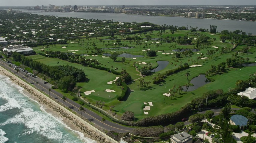 5K stock footage aerial video of oceanfront golf course in Palm Beach, Florida Aerial Stock Footage | AX0019_054