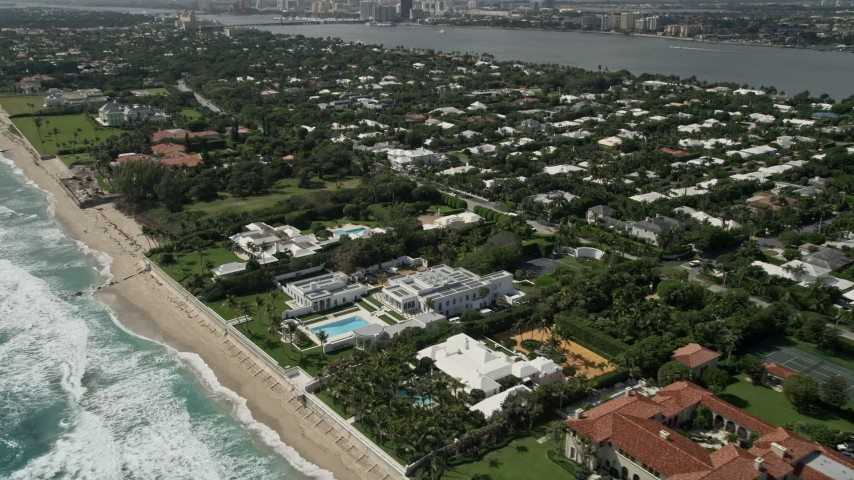 5K stock footage aerial video fly over and tilt to oceanfront mansions in Palm Beach, Florida Aerial Stock Footage | AX0019_055