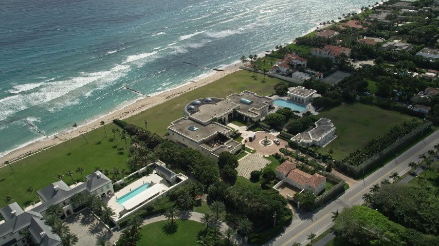 5K stock footage aerial video of a spacious oceanfront mansion in Palm Beach, Florida Aerial Stock Footage | AX0019_056