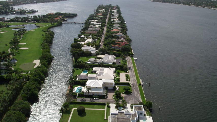 5K stock footage aerial video approach and fly over lakefront mansions in Palm Beach  Aerial Stock Footage | AX0019_063