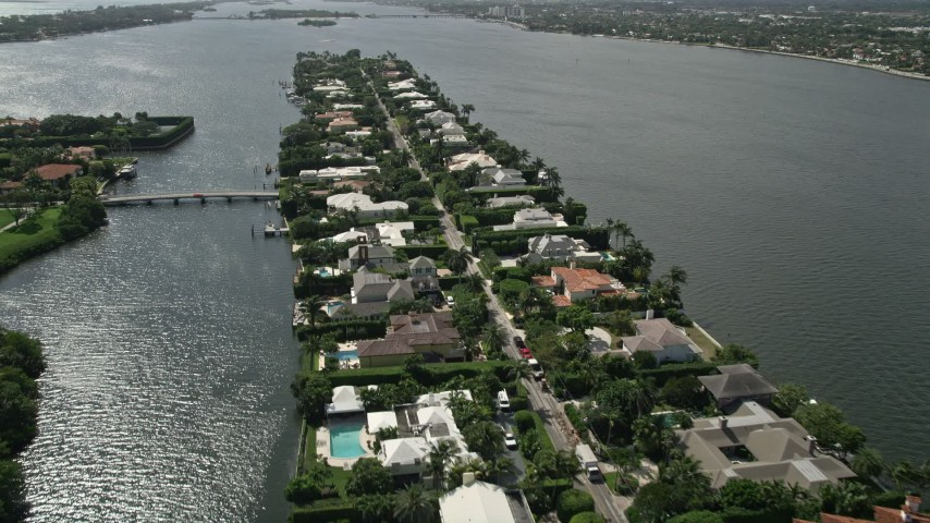 5K stock footage aerial video approach and fly over lakefront mansions in Palm Beach Aerial Stock Footage | AX0019_063E