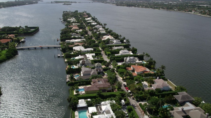 5K stock footage aerial video fly over lakefront mansions on a small Palm Beach Island, Florida Aerial Stock Footage | AX0019_064
