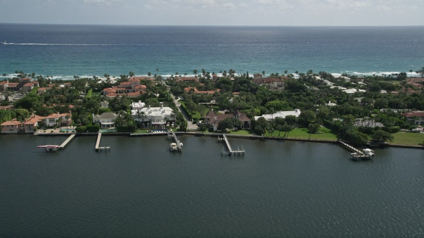 5K stock footage aerial video of lakefront mansions with docks in Palm Beach, Florida Aerial Stock Footage | AX0019_066