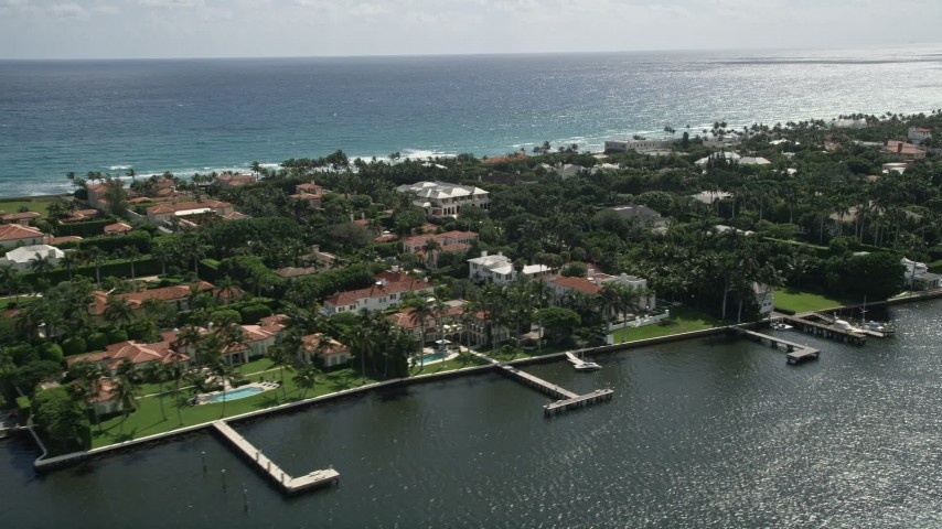 5K stock footage aerial video flyby lakefront mansions with docks in Palm Beach, Florida Aerial Stock Footage | AX0019_067