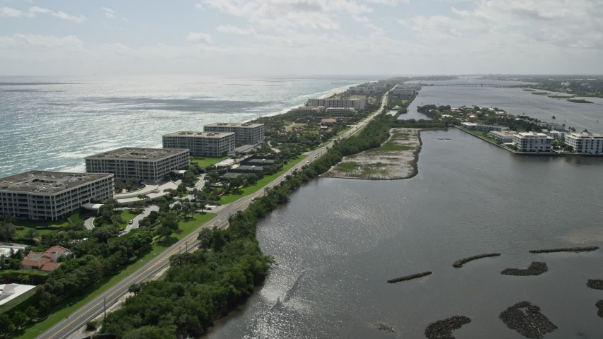 5K stock footage aerial video of oceanfront office buildings by a Lakeside Road in Palm Beach, Florida Aerial Stock Footage | AX0019_071