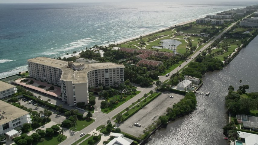 5K stock footage aerial video of oceanfront condominiums and golf course in Palm Beach, Florida Aerial Stock Footage | AX0019_072