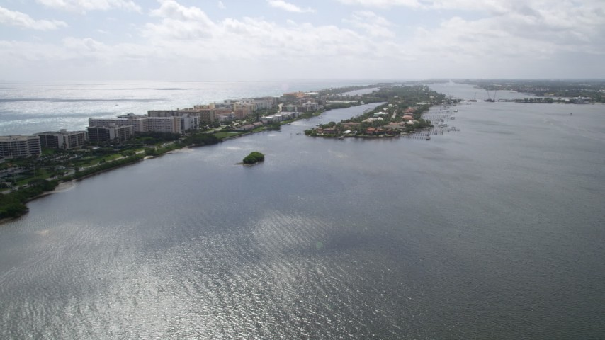 5K stock footage aerial video approach lakefront mansions on a small island on Lake Worth in Palm Beach, Florida Aerial Stock Footage | AX0019_073