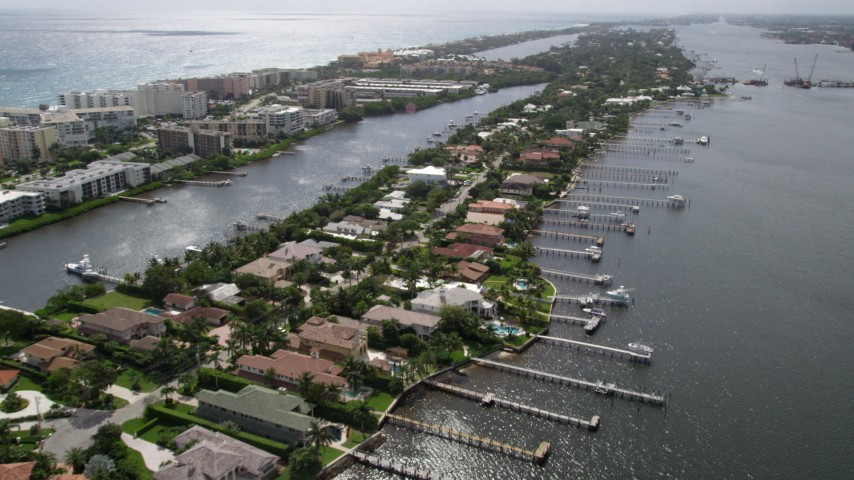 5K stock footage aerial video flyby lakefront mansions with docks on an island in Palm Beach, Florida Aerial Stock Footage | AX0019_075