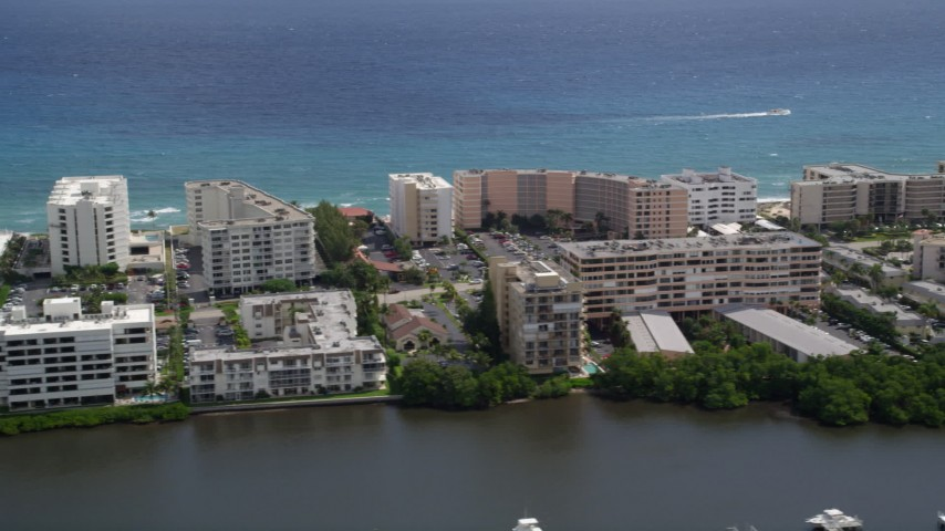 5K aerial video flyby waterfront hotel and apartment buildings in Palm Beach, Florida Aerial Stock Footage | AX0019_076