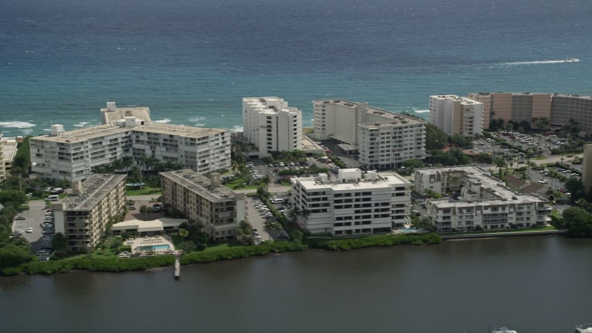 5K stock footage aerial video flyby waterfront hotel and apartment buildings in Palm Beach, Florida Aerial Stock Footage   AX0019_076E