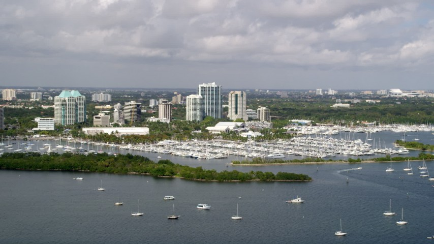 5K stock footage aerial video of sailboats at Dinner Key Marina in Coconut Grove, Florida Aerial Stock Footage | AX0020_002