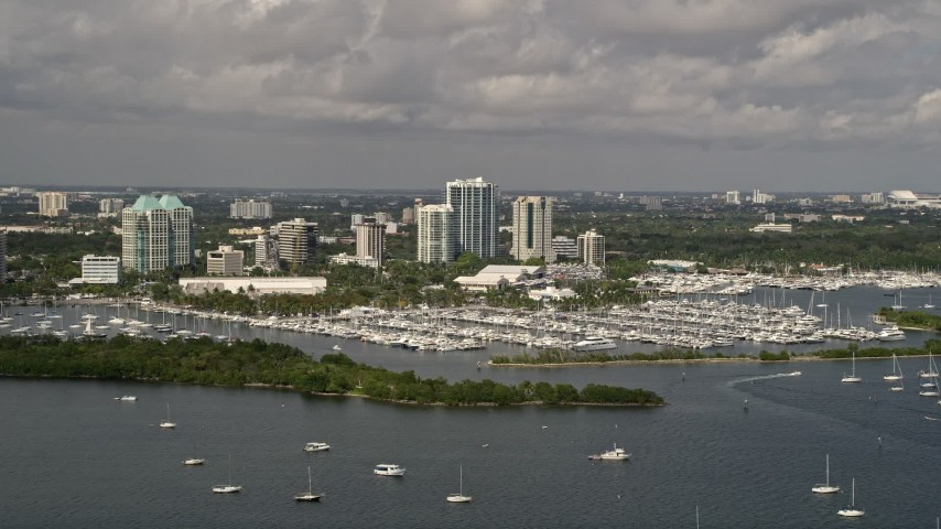 5K stock footage aerial video of sailboats at Dinner Key Marina in Coconut Grove, Florida Aerial Stock Footage   AX0020_002E