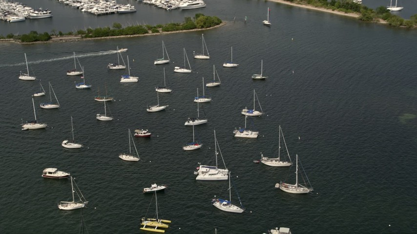 5K stock footage aerial video of sailboats moored outside Dinner Key Marina in Coconut Grove, Florida Aerial Stock Footage | AX0020_004