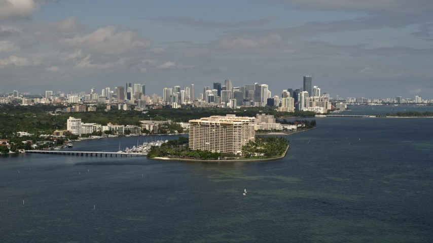 5K stock footage aerial video approach condo complexes on Grove Isle with Downtown Miami skyline in background, Florida Aerial Stock Footage | AX0020_005