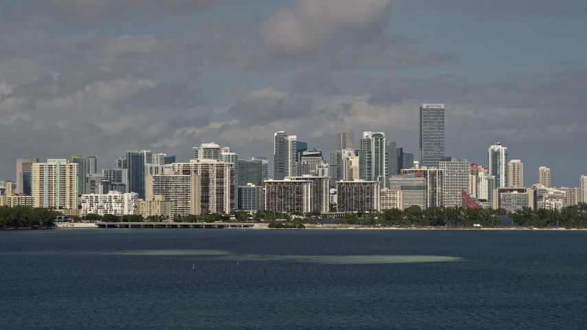 5K aerial video tilt from the bay to reveal the Downtown Miami skyline in Florida Aerial Stock Footage | AX0020_010