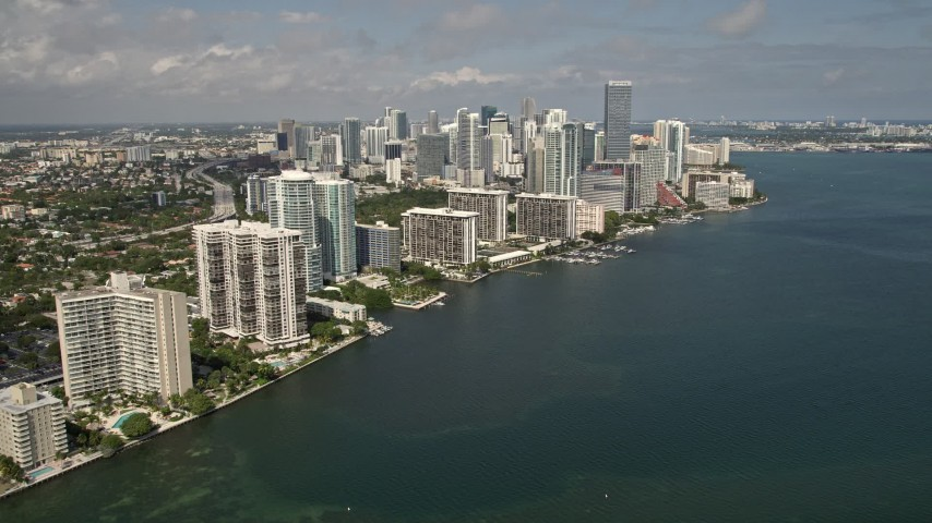 5K stock footage aerial video of tilt from Rickenbacker Causeway to reveal condominiums and skyscrapers of Downtown Miami, Florida Aerial Stock Footage | AX0020_018