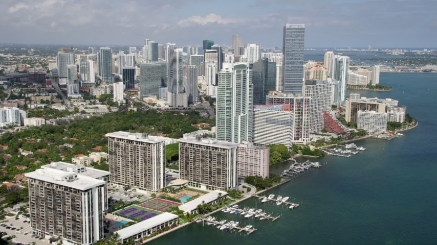 5K stock footage aerial video flyby bayfront condominium complexes to approach Downtown Miami skyscrapers, Florida Aerial Stock Footage | AX0020_019