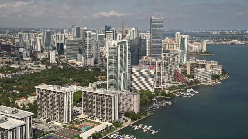 5K stock footage aerial video flyby bayfront condominium complexes to approach Downtown Miami hotel and skyscrapers, Florida Aerial Stock Footage | AX0020_019E