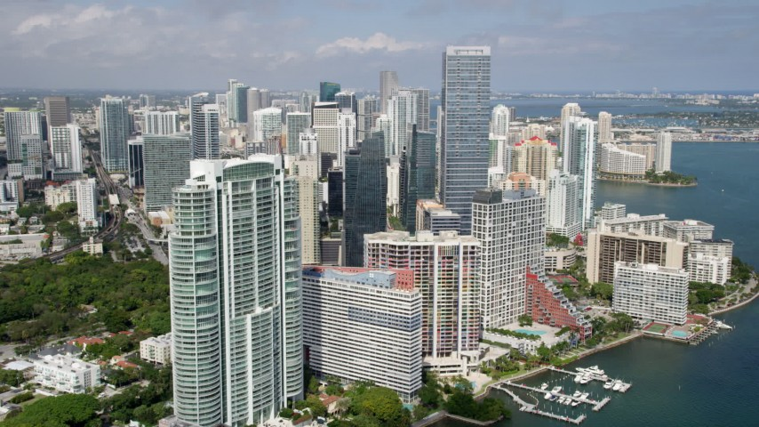 5K stock footage aerial video flyby modern condo complex to approach Downtown Miami skyscrapers in Florida Aerial Stock Footage | AX0020_020