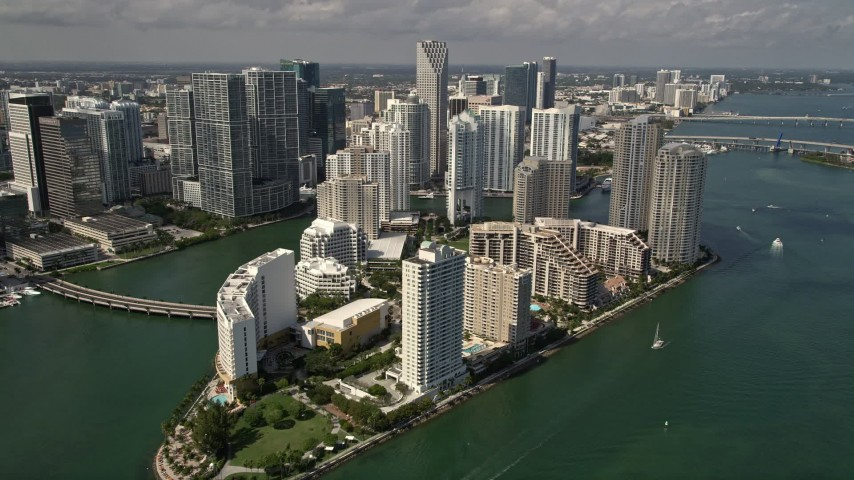 5K stock footage aerial video of waterfront hotels and skyscrapers on Brickell Key in the coastal city of Miami, Florida Aerial Stock Footage | AX0020_024