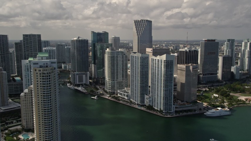 5K stock footage aerial video flyby Brickell Key skyscrapers to reveal Miami River through Downtown Miami, Florida Aerial Stock Footage | AX0020_025