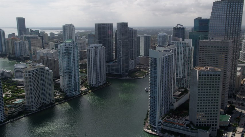 5K stock footage aerial video of skyscrapers on the riverbanks of the Miami River in Downtown Miami, Florida Aerial Stock Footage | AX0020_027