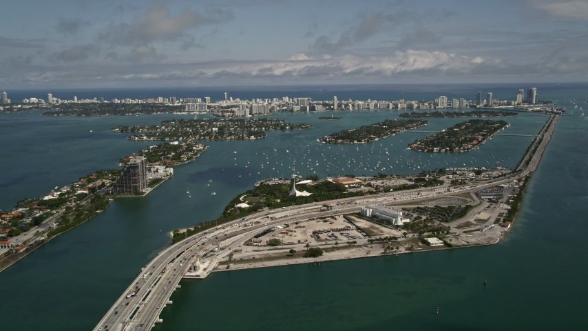 5K stock footage aerial video of MacArthur Causeway and Watson Island on the coast in Biscayne Bay, Florida Aerial Stock Footage | AX0020_031