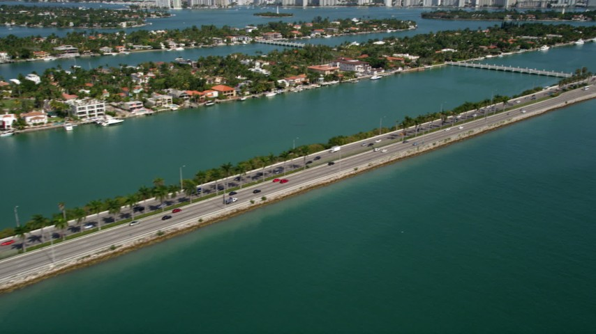 5K aerial video of MacArthur Causeway with light traffic and Palm Island in Miami, Florida Aerial Stock Footage | AX0020_035
