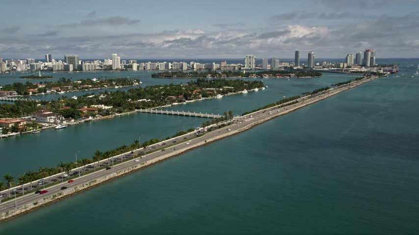 5K stock footage aerial video of MacArthur Causeway with light traffic and Palm Island in Miami, Florida Aerial Stock Footage | AX0020_035E