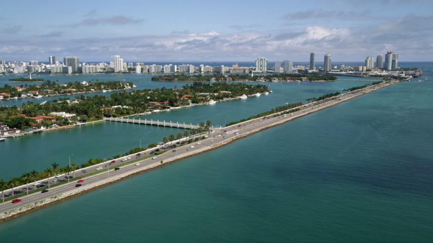 5K stock footage aerial video flyby the MacArthur Causeway spanning Biscayne Bay in Miami, Florida Aerial Stock Footage AX0020_036 | Axiom Images