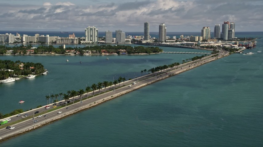 5K stock footage aerial video tilt from light traffic on MacArthur Causeway to reveal South Beach, Florida Aerial Stock Footage | AX0020_037