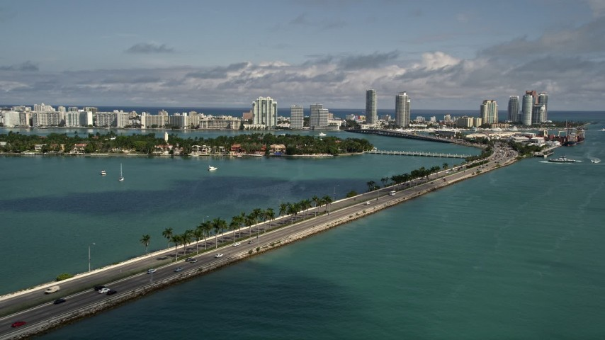 5K aerial video of light traffic on the MacArthur Causeway heading to and from South Beach, Florida Aerial Stock Footage | AX0020_038