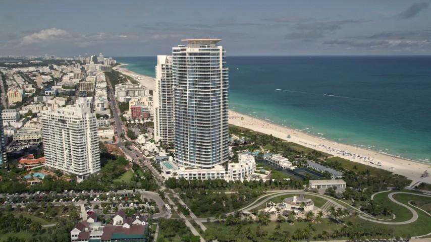 5K stock footage aerial video orbit modern beachfront skyscrapers in South Beach, Florida Aerial Stock Footage | AX0020_043