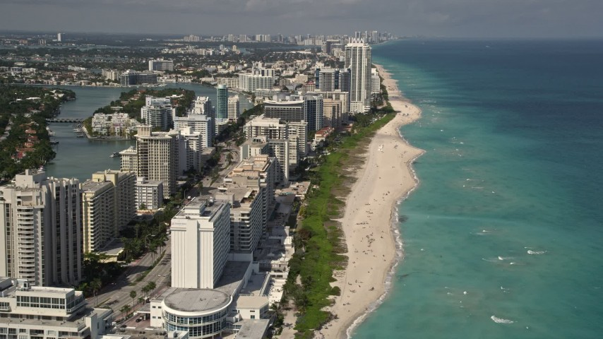 5K stock footage aerial video fly over beachfront condominiums with ocean views in Miami Beach, Florida Aerial Stock Footage | AX0020_058