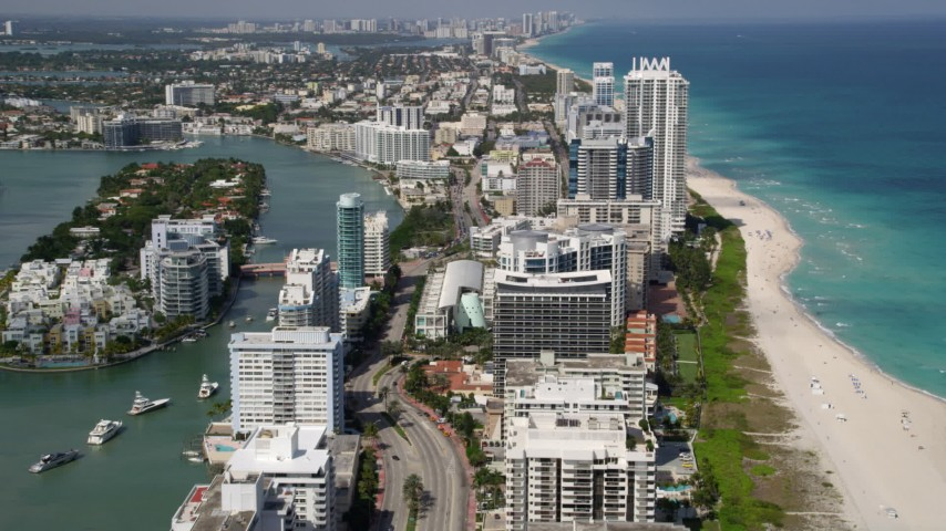5K stock footage aerial video fly over beachfront condos on the coast in Miami Beach, Florida Aerial Stock Footage | AX0020_059