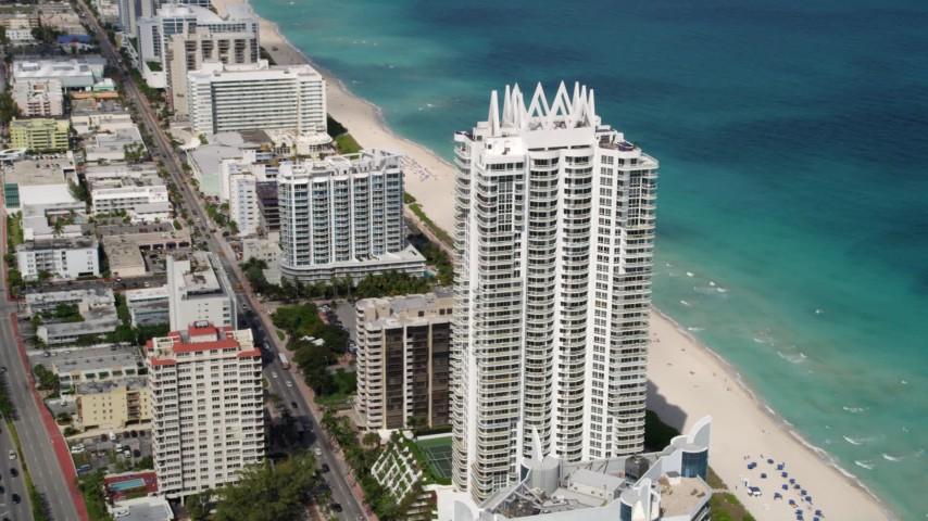 5K stock footage aerial video of beachfront condominium skyscraper and hotels in Miami Beach, Florida Aerial Stock Footage | AX0020_061