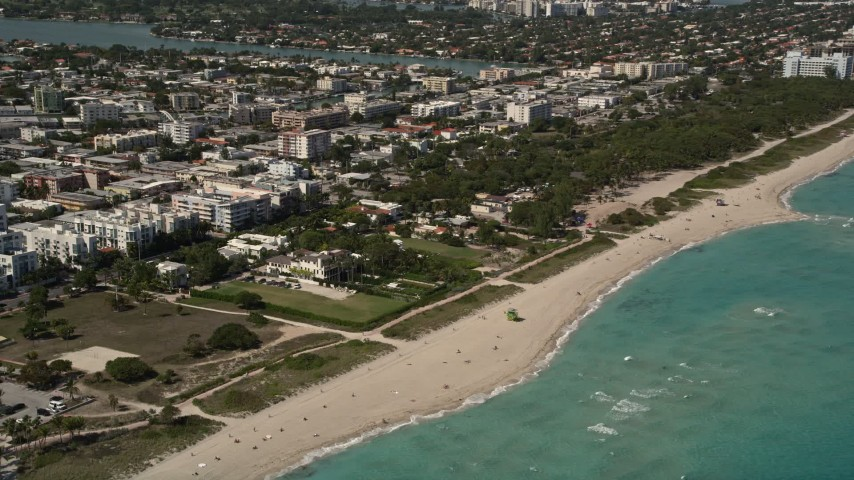 5K stock footage aerial video approach beachfront homes with ocean views in Miami Beach, Florida Aerial Stock Footage | AX0020_064