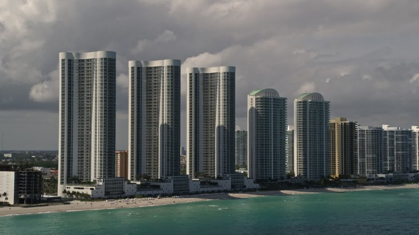 5K stock footage aerial video of Trump Towers skyscrapers on the shore of Sunny Isles Beach, Florida Aerial Stock Footage | AX0020_074