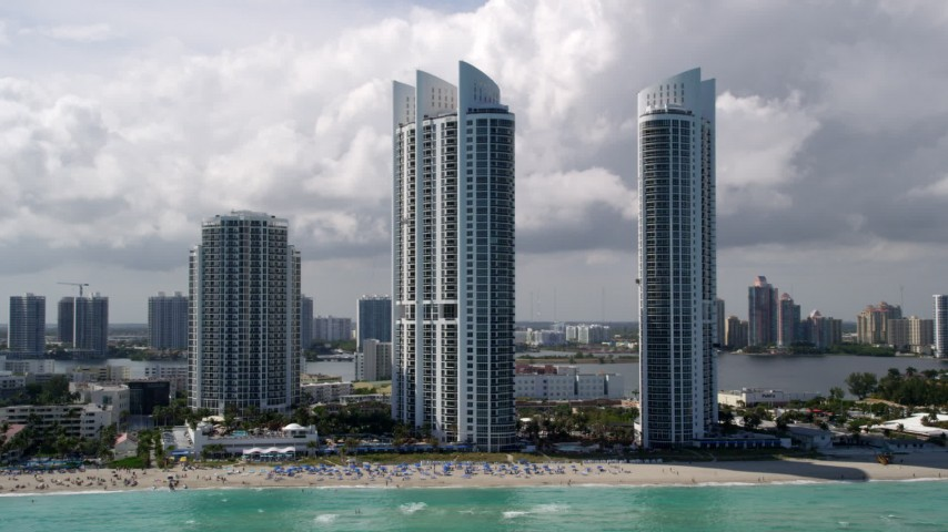 5K stock footage aerial video of beachfront luxury resort hotels in Sunny Isles Beach, Florida Aerial Stock Footage AX0020_080 | Axiom Images