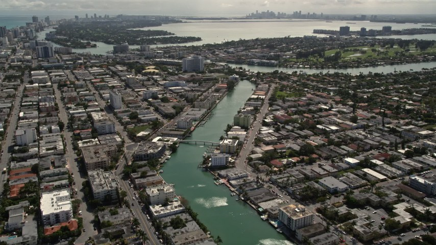 5K stock footage aerial video of waterfront property on a canal through Miami Beach, Florida Aerial Stock Footage | AX0020_097