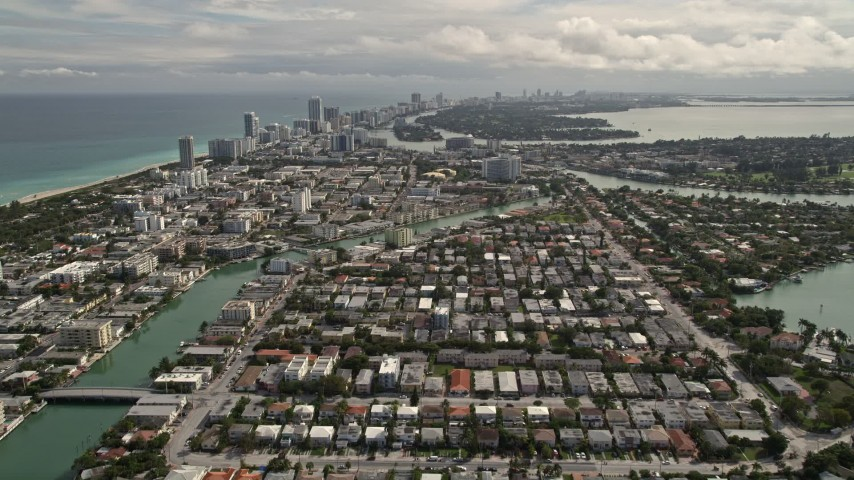 5K stock footage aerial video tilt from Surfside neighborhoods to reveal Biscayne Point and Miami Beach, Florida Aerial Stock Footage | AX0021_017E