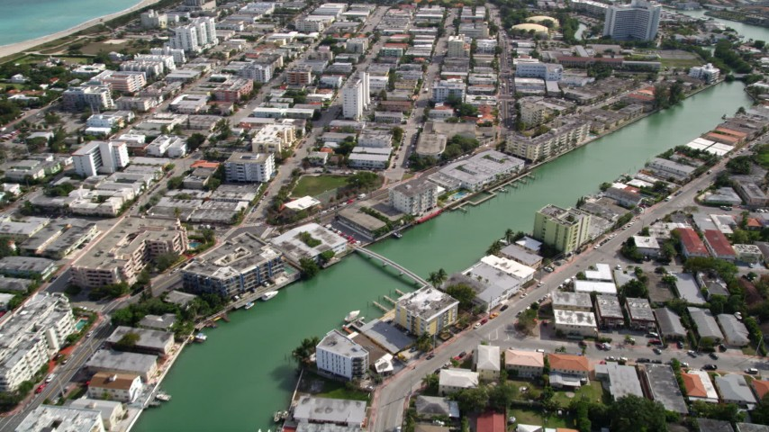 5K stock footage aerial video fly over apartment buildings lining canal between Biscayne Point and Miami Beach, Florida Aerial Stock Footage | AX0021_019