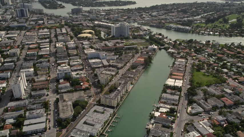5K stock footage aerial video fly over apartment buildings lining canal between Biscayne Point and Miami Beach, Florida Aerial Stock Footage | AX0021_019E