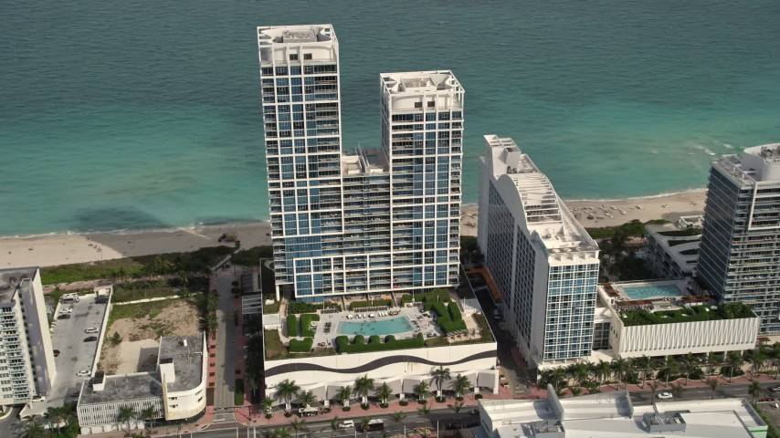 5K stock footage aerial video of an oceanfront hotel in Miami Beach, Florida Aerial Stock Footage | AX0021_022E