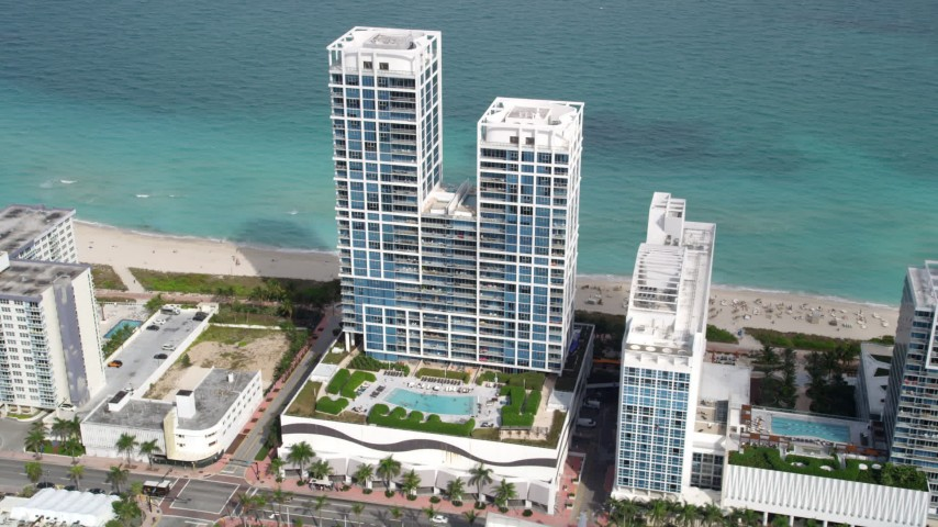5K stock footage aerial video of a beachfront hotel in Miami Beach, Florida Aerial Stock Footage | AX0021_023
