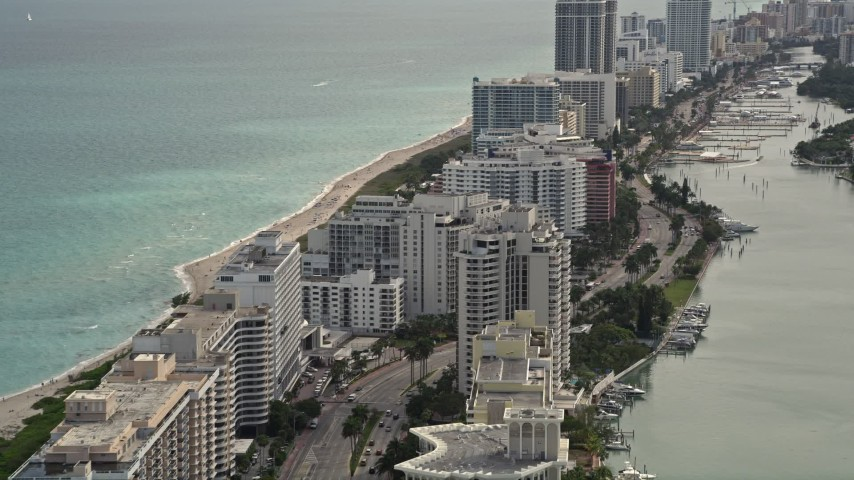 5K stock footage aerial video fly over beachfront condominiums on Collins Avenue in Miami Beach, Florida Aerial Stock Footage | AX0021_025E