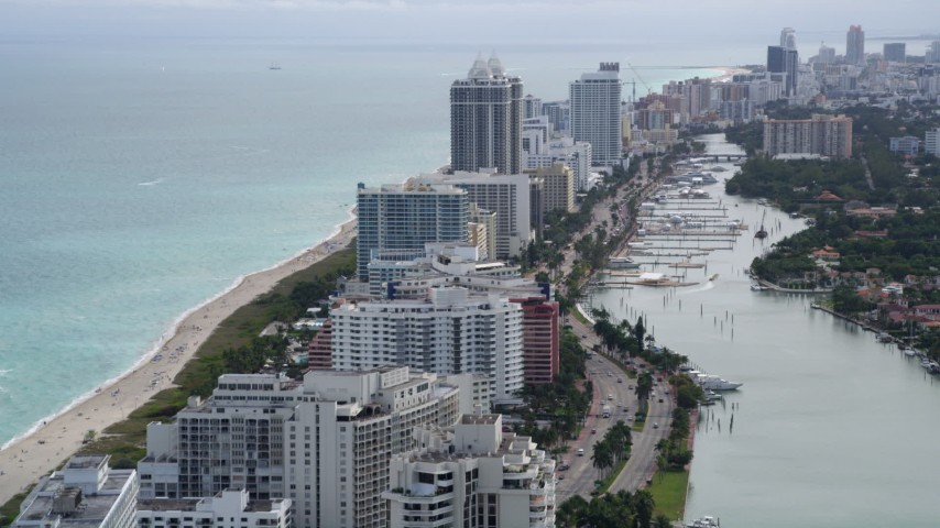 5K stock footage aerial video fly over beachfront condo buildings to approach Blue and Green Diamonds in Miami Beach, Florida Aerial Stock Footage | AX0021_026