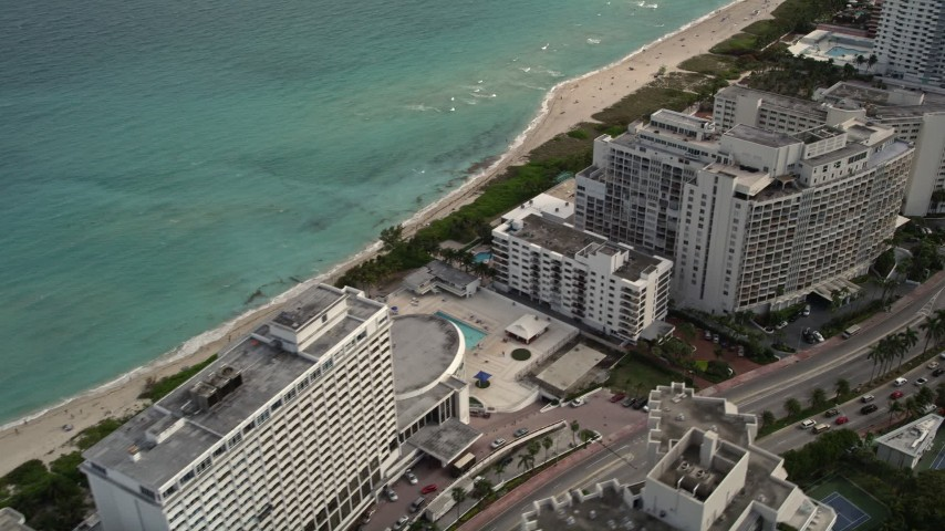 5K aerial video of condominiums by the beach in Miami Beach, Florida Aerial Stock Footage | AX0021_027